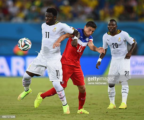 Sulley Muntari of Ghana and Alejandro Bedoya of the United States battle for the ball during the 2014 FIFA World Cup Brazil Group G match between...