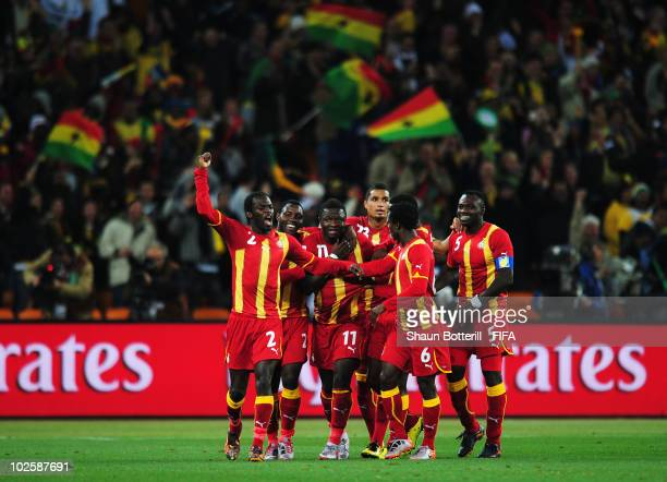 Sulley Muntari of Ghana celebrates with team mates after he scores his side's first goal during the 2010 FIFA World Cup South Africa Quarter Final...