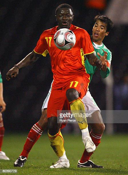Sulley Muntari of Ghana competes for the ball against Pavel Pardo of Mexico during the International Friendly match between Ghana and Mexico at...