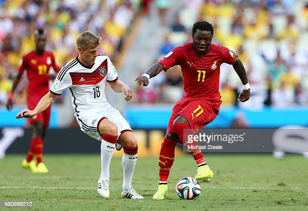 Sulley Muntari of Ghana controls the ball against Toni Kroos of Germany during the 2014 FIFA World Cup Brazil Group G match between Germany and Ghana...