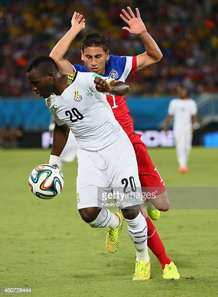 Sulley Muntari of Ghana fights off Alejandro Bedoya during the 2014 FIFA World Cup Brazil Group G match between Ghana and the United States at...