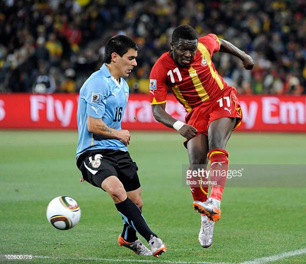 Sulley Muntari of Ghana kicks the ball past Maximiliano Pereira of Uruguay during the 2010 FIFA World Cup South Africa Quarter Final match between...