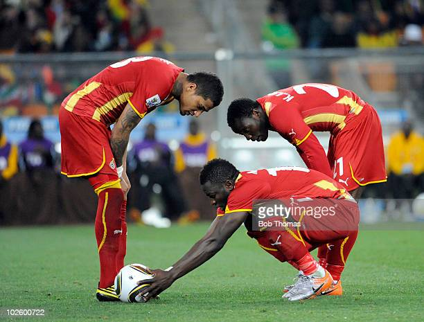 Sulley Muntari of Ghana places the ball for a penalty watched by teammates Kwandwo Asamoah and Kevin Prince Boateng during the 2010 FIFA World Cup...