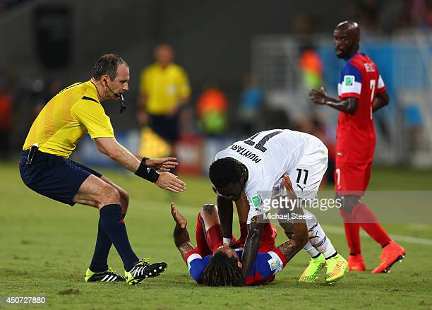 Sulley Muntari of Ghana reacts angrily after a challenge by Jermaine Jones of the United States as referee Jonas Eriksson runs on during the 2014...