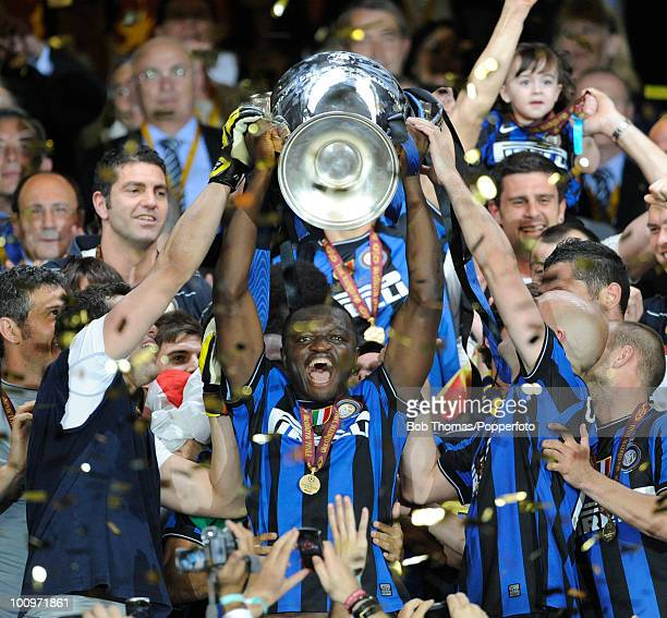 Sulley Muntari of Inter Milan celebrates with the trophy after winning the UEFA Champions League Final match between Bayern Munich and Inter Milan at...