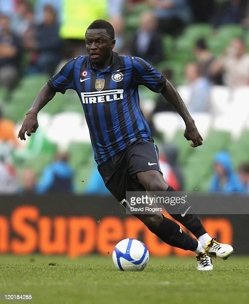 Sulley Muntari of Inter Milan runs with the ball during the Dublin Super Cup match between Inter Milan and Manchester City at the Aviva Stadium on...