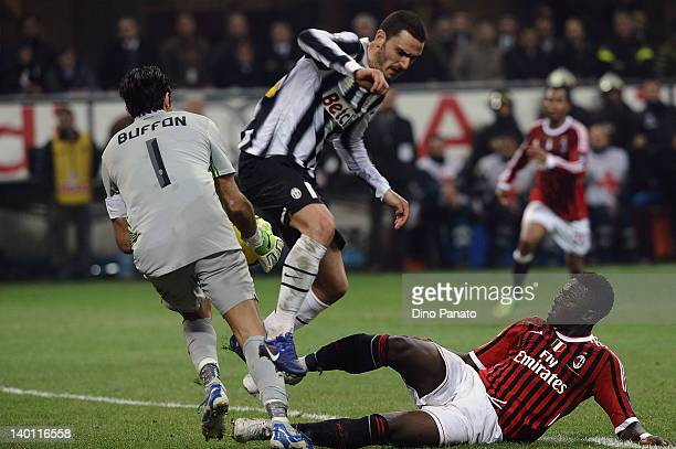Sulley Muntari of Milan competes with Leonardo Bonucci and Gianluigi Buffon, goalkeeper of Juventus during the Serie A match between AC Milan and...