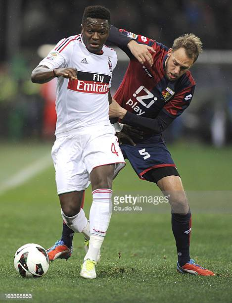 Sulley Muntary of AC Milan and Andreas Granqvist of Genoa CFC compete for the ball during the Serie A match between Genoa CFC and AC Milan at Stadio...