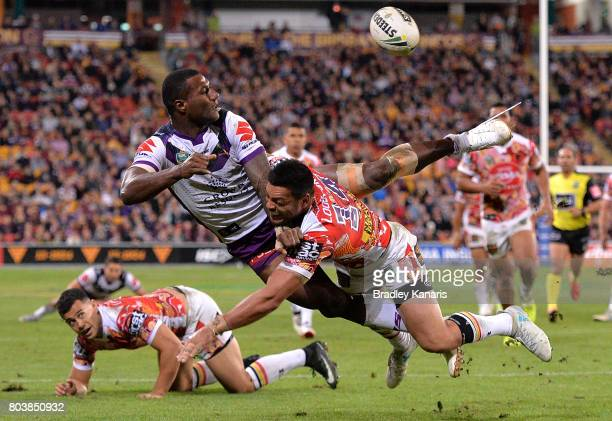 Sullies Vunivalu of the Storm gets a plays a shots away during the round 17 NRL match between the Brisbane Broncos and the Melbourne Storm at Suncorp...