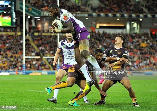 Sullies Vunivalu of the Storm out jumps Anthony Milford of the Broncos to score a try during the round 17 NRL match between the Brisbane Broncos and...