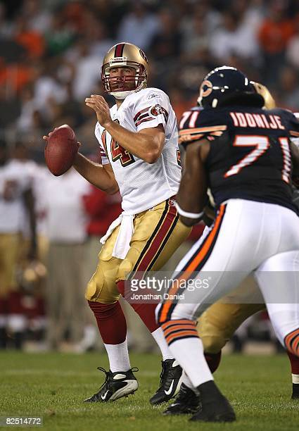 Sullivan of the San Francisco 49ers looks for a receiver as Israel Idonije of the Chicago Bears rushes on August 21 2008 at Soldier Field in Chicago...