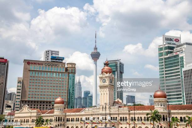 sultan abdul samad building with kuala lumpur office buildings - menara kuala lumpur tower stock photos and pictures