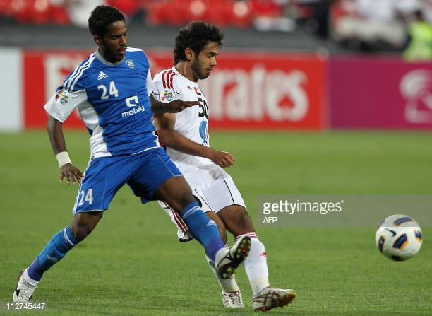 Sultan Barghash of UAE's AlJazira challenges Nawaf alAbid of Saudi Arabia's AlHilal during their AFC Champions League group A football match at...