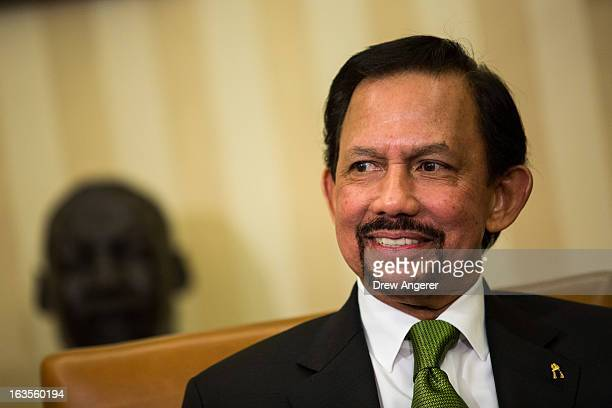 Sultan Haji Hassanal Bolkiah of Brunei attends a bilateral meeting with US President Barack Obama in the Oval Office at the White House on March 12...
