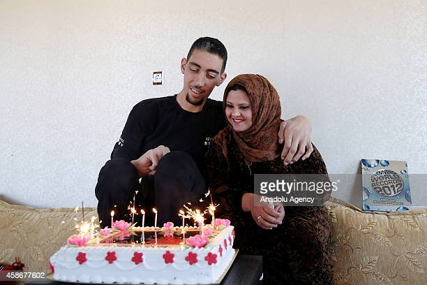 Sultan Kosen world's tallest living male at 251 meters and his wife Merve Dibo look at their cake on their wedding anniversary in Mardin Turkey on...