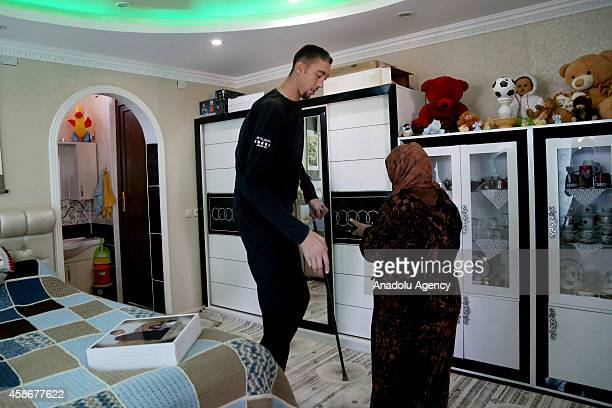 Sultan Kosen world's tallest living male at 251 meters and his wife Merve Dibo are seen at home on their wedding anniversary in Mardin Turkey on...