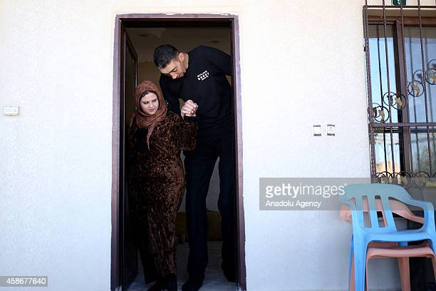 Sultan Kosen world's tallest living male at 251 meters and his wife Merve Dibo walk out of their home on their wedding anniversary in Mardin Turkey...