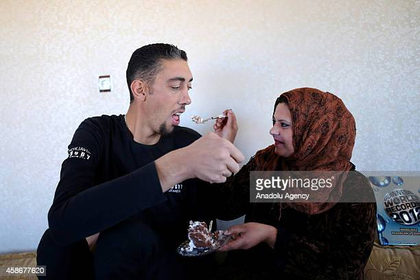 Sultan Kosen world's tallest living male at 251 meters gives cake to his wife Merve Dibo on their wedding anniversary in Mardin Turkey on November 9...
