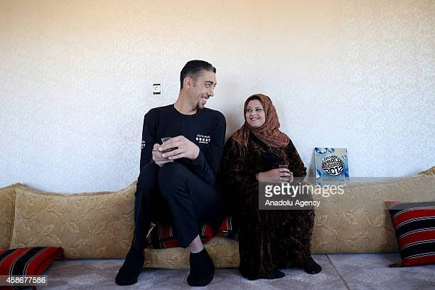 Sultan Kosen world's tallest living male at 251 meters poses with his wife Merve Dibo on their wedding anniversary in Mardin Turkey on November 9...