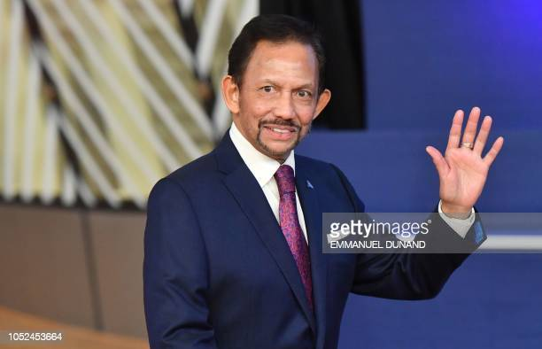 Sultan of Brunei Haji Hassanal Bolkiah waves as he arrives for a Asia Europe Meeting at the European Council in Brussels on October 18 2018
