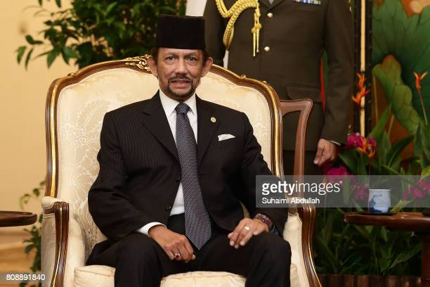 Sultan of Brunei Hassanal Bolkiah attends a courtesy call to meet with Singapore President Tony Tan Keng Yam at the Istana on July 5 2017 in...