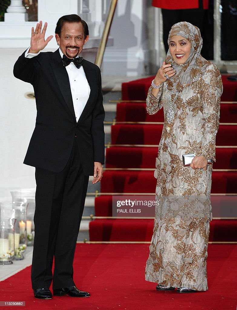 Sultan of Brunei Hassanal Bolkiah (L) poses at the Mandarin Oriental hotel for a gala dinner hosted by Britain's Queen Elizabeth II in London on April 28, 2011 on the eve of the Royal wedding. Britain's Prince William is to marry his fiancee Kate Middleton at Westminster Abbey in London on April 29, 2011.