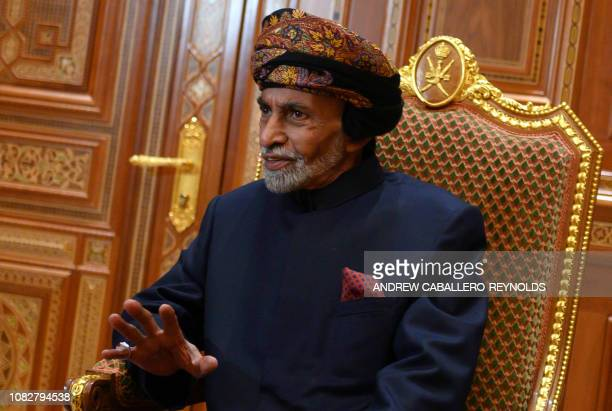 Sultan of Oman Qaboos bin Said alSaid sits during a meeting with the US secretary of state at the Beit Al Baraka Royal Palace in Muscat on January 14...