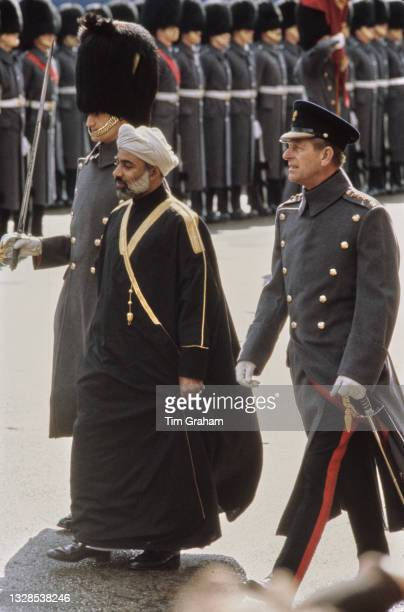 Sultan of Oman Qaboos bin Said and British Royal Prince Philip, Duke of Edinburgh during an inspection of the Queen's Guard - the grey coats are worn...