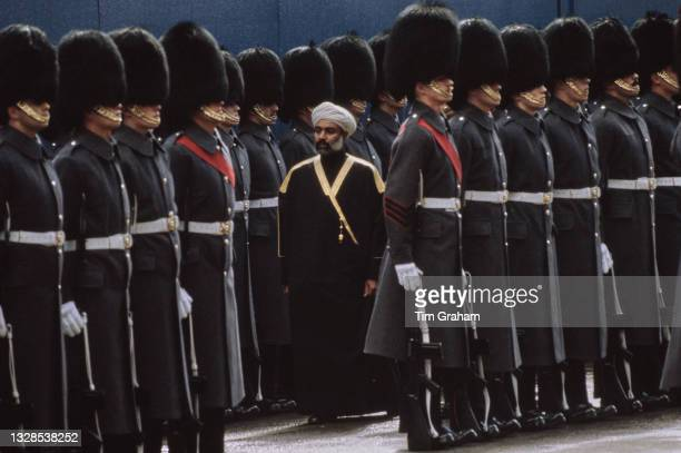 Sultan of Oman Qaboos bin Said during an inspection of the Queen's Guard - the grey coats are worn in wet or cold weather - in London, England, March...