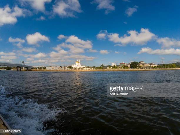 sultan omar ali saifuddien mosque in brunei darusallam view from the boat - brunei stock pictures, royalty-free photos & images