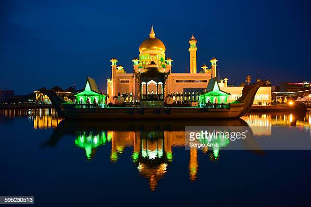 sultan omar ali saifuddin mosque at dusk - bandar seri begawan stock photos and pictures