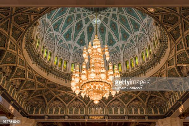 sultan qaboos grand mosque chandelier - sultan qaboos mosque stock pictures, royalty-free photos & images