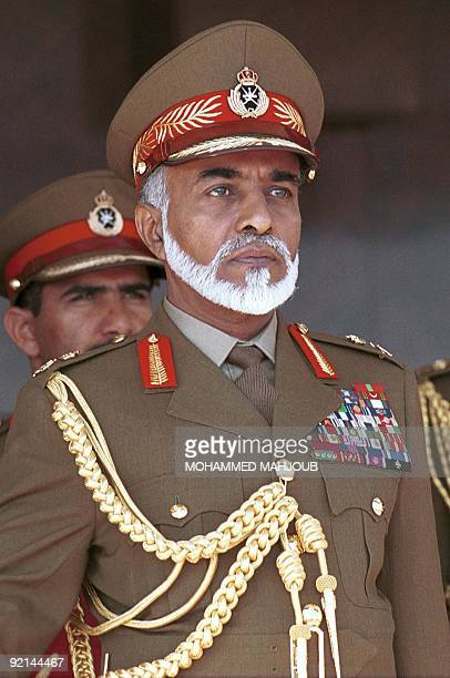 Sultan Qaboos of Oman attends a military parade on the occasion of the country's National Day in Muscat 18 November 2001 AFP PHOTO/Mohammed MAHJOUB