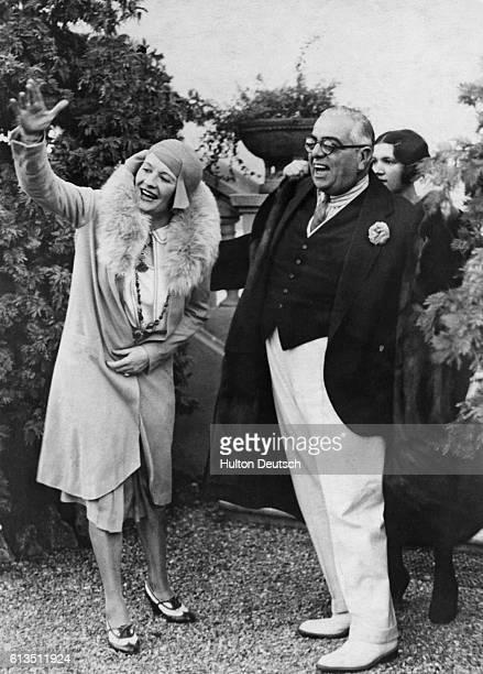 Sultan Sir Muhammed Shah, Aga Khan III and his wife Mata Salamat, Begum Aga Khan III smile and wave to people in England.