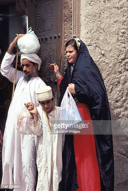 Sultanate Of Oman Nizwa Souk Family With Shopping Bags
