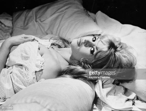 Sultry French actress Brigitte Bardot in bed.