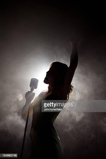 Sultry singer back lit