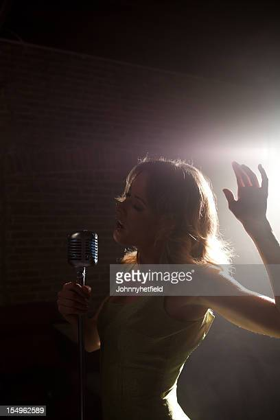 Sultry singer on a smokey stage