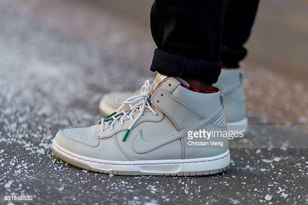 Suly wearing Nike sneaker at Wood during Milan Men's Fashion Week Fall/Winter 2017/18 on January 16 2017 in Milan Italy