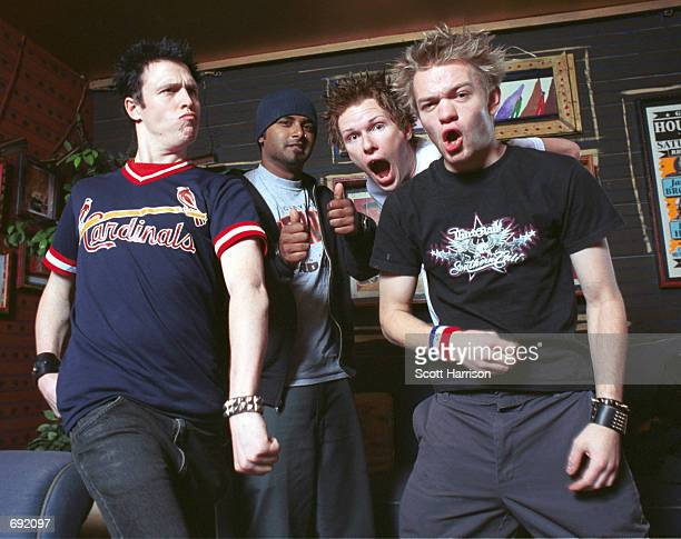 Sum 41 band members Steve Jocz Dave Baksh Cone McCaslin and Deryck Whibley pose backstage January 18 2002 before performing at the House of Blues in...
