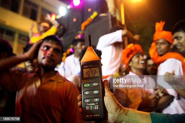 Sumaira Abdulali noise activist and environmentalists' sound level meter measures 1073 decibels during an immersion procession on the final day of...