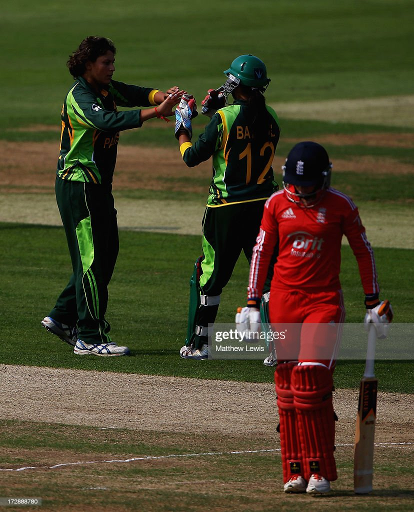 Sumaiya Siddiqi of Pakistan is congratulated by Batool Fatima, after bowling Lauren Winfield of England during the 2nd NatWest Women's International T20 match between England Women and Pakistan Women on July 5, 2013 in Loughborough, England.