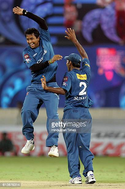 T Suman of the Chargers celebrates with Ojha during the Airtel Champions League Twenty20 Group A match between the Deccan Chargers and Somerset CCC...
