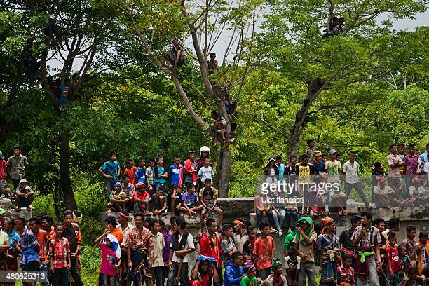 Sumbanese people attend the pasola war festival at Wainyapu village on March 25 2014 in Sumba Island Indonesia The Pasola Festival is an important...