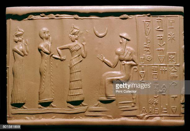 Sumerian cylinderseal impression depicting Haskhamer Governor of the city of Ishkunsin is introduced to the King of Ur who is seated by the goddess...