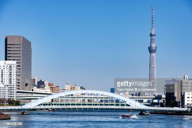 sumida river and tokyo sky tree in tokyo of japan - 永代橋 ストックフォトと画像