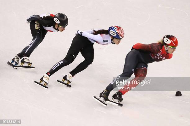 Sumire Kikuchi of Japan Alang Kim of Korea and Marianne St Gelais of Canada compete during the Ladies Short Track Speed Skating 1000m Heats on day...