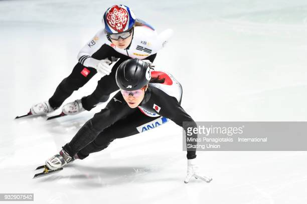 Sumire Kikuchi of Japan competes against Min Jeong Choi of Korea in the women's 500 meter heats during the World Short Track Speed Skating...