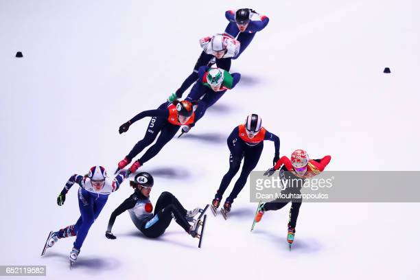 Sumire Kikuchi of Japan falls on the ice and crashes out of the 1500m Semifinals race at ISU World Short track Speed Skating Championships held at...