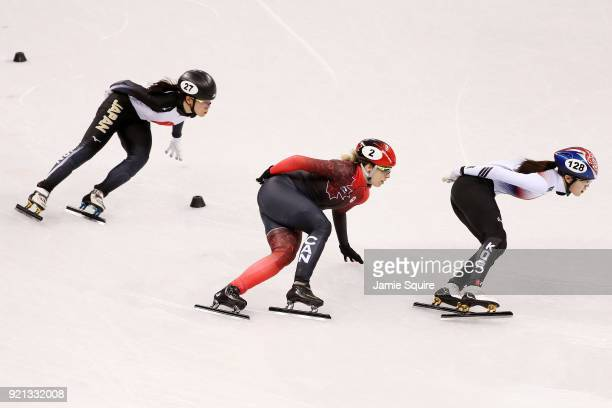 Sumire Kikuchi of Japan Marianne St Gelais of Canada and Alang Kim of Korea compete during the Ladies Short Track Speed Skating 1000m Heats on day...